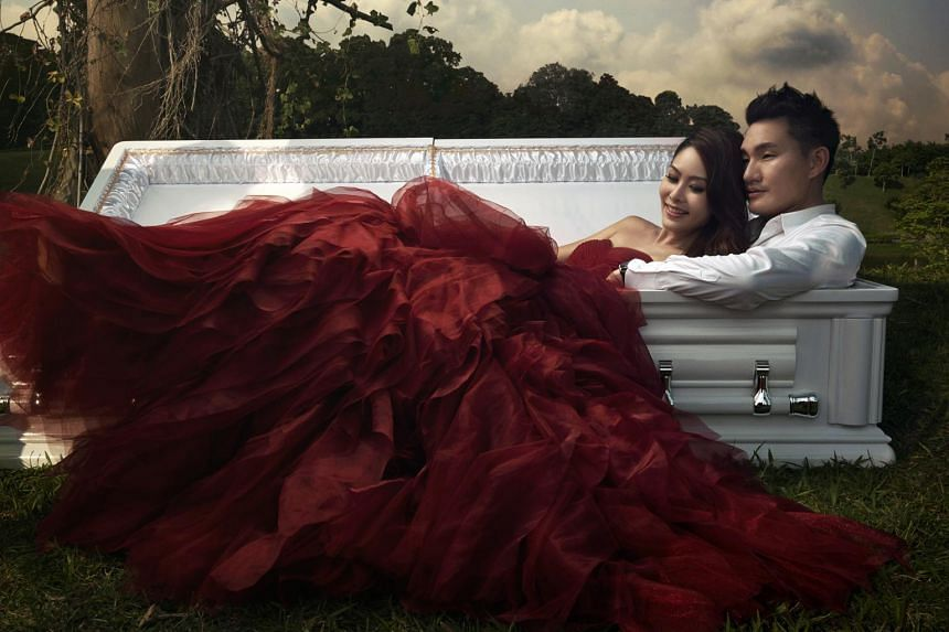 Their lives are inextricably linked to their profession so Jenny Tay and Darren Cheng decided on wedding photos featuring a casket as a prop.