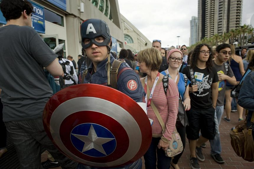 Comic-Con convention goers walk outside the San Diego Convention Center on the second day of Comic-Con 2015, in San Diego, California, on July 10, 2015.
