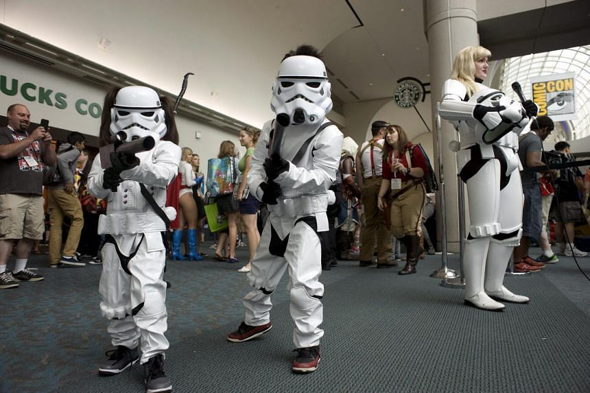Two children dressed as Star Wars characters pose for a photograph during Comic-Con 2015 at the San Diego Convention Center in San Diego, California, on July 9, 2015.