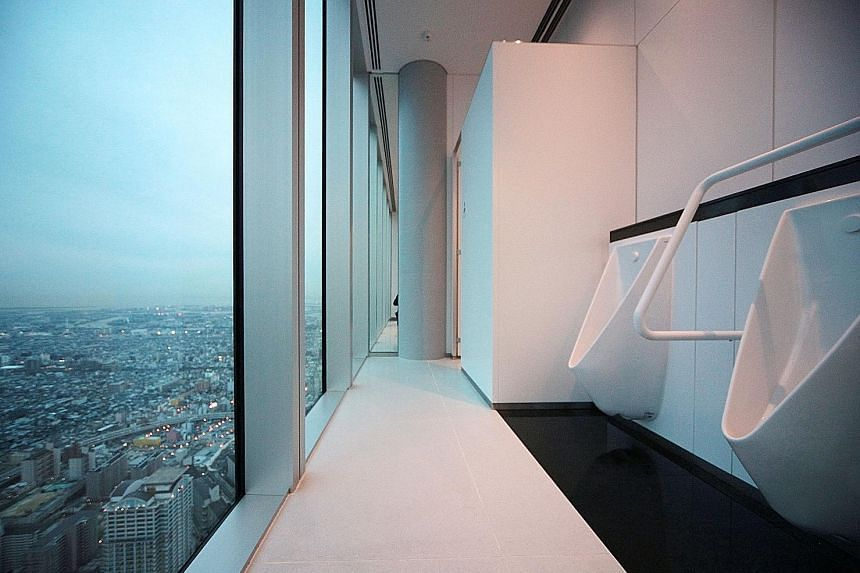 A restroom (above) in the Abeno Harukas building in Osaka, Japan. Solo toilets remain a dream.