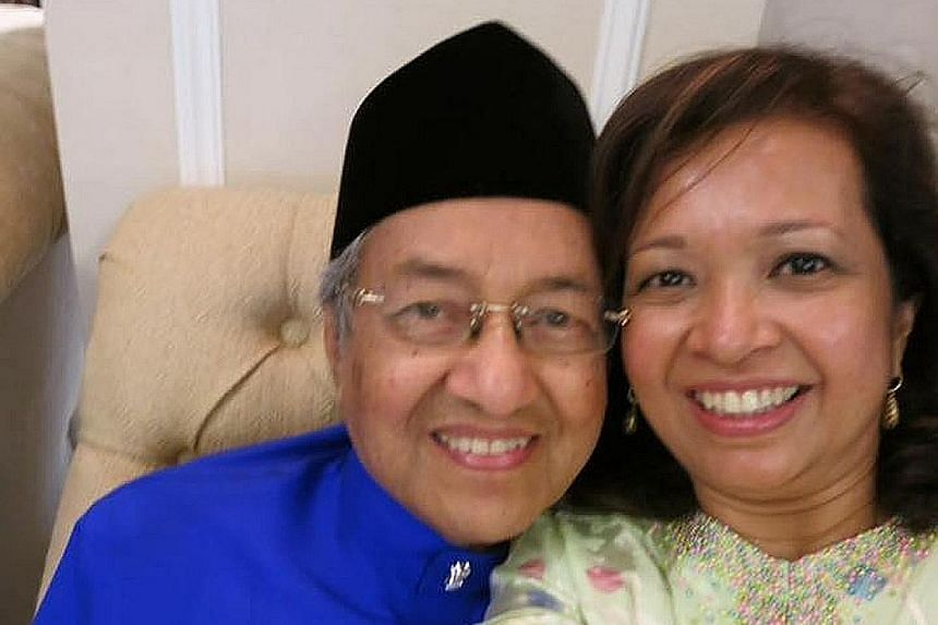 Dr Mahathir Mohamad with his daughter Marina. The statesman turned 90 yesterday and is still sprightly.