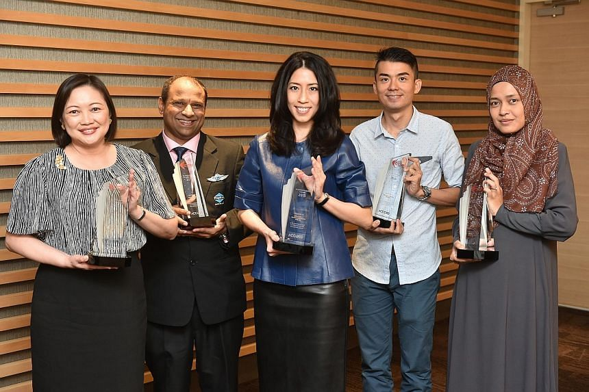 Recipients of the revamped Total Defence Awards (from left): Mrs Carol Lim, principal of Evergreen Secondary School; Mr Mohamed Ismail Gafoor, CEO, PropNex Realty; Mrs Grace Chong-Tan, managing director of Smile Inc Dental Surgeons; Mr Patrick Koh, N