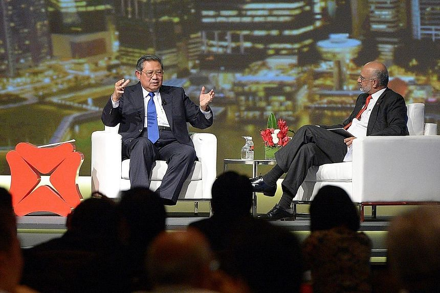 Former Indonesian President Susilo Bambang Yudhoyono (above left) speaking at the DBS Asia Leadership Dialogue, which was hosted by DBS chief Piyush Gupta.