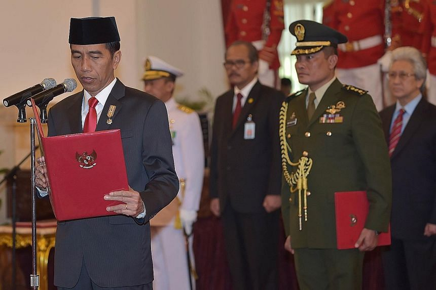 President Joko Widodo at the swearing-in ceremony of General Gatot Nurmantyo (right) as armed forces chief at the presidential palace in Jakarta this week.