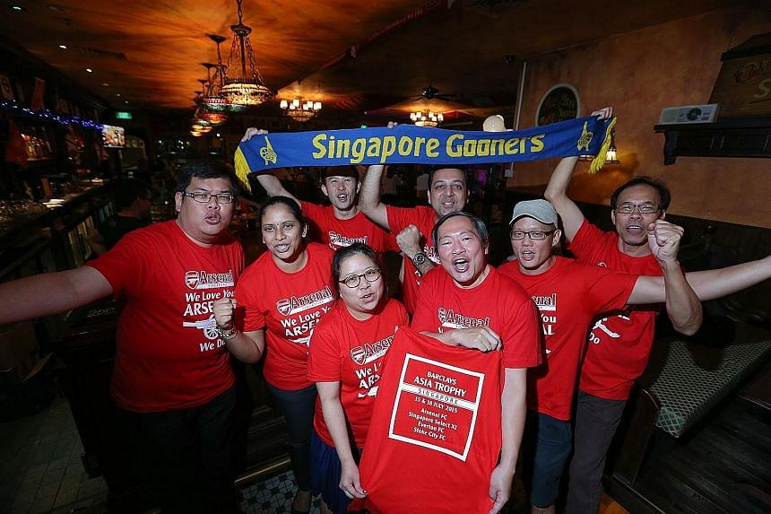 The Official Arsenal Singapore Supporters Club hosted an event in which they distributed to members match tickets and commemorative T-shirts on Thursday ahead of the Barclays Asia Trophy.