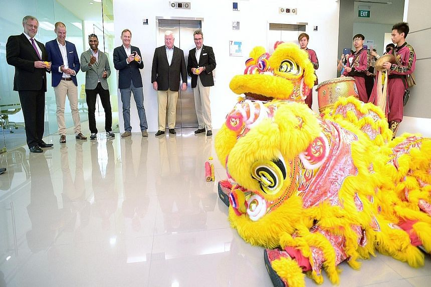 Hans-Joachim Watzke (fourth from left), at the soft launch of the Singapore office, retains fans' loyalty by not raising ticket prices.