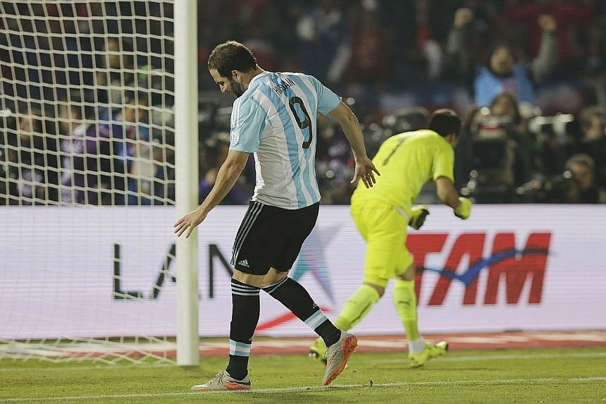 Striker Gonzalo Higuain (left) did not have a memorable Copa America campaign, missing his penalty kick against Chile in the final.