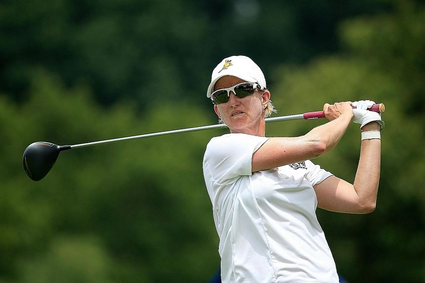 Seven-time Major champion Karrie Webb of Australia teeing off on the 18th hole in the first round of the US Women's Open, which she has won twice before. While she is joint leader, holder Michelle Wie is already six shots back, although she remains u