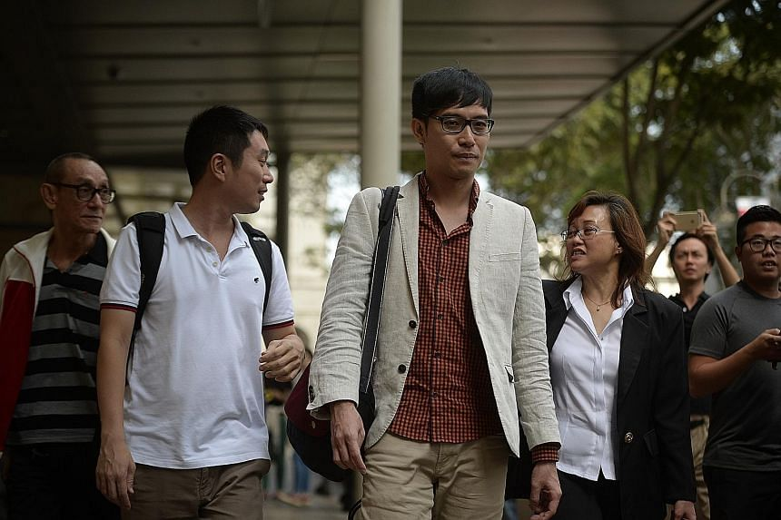Mr Roy Ngerng (centre) was ordered to pay $6,000 to PM Lee for the unsuccessful bid to hire a QC.