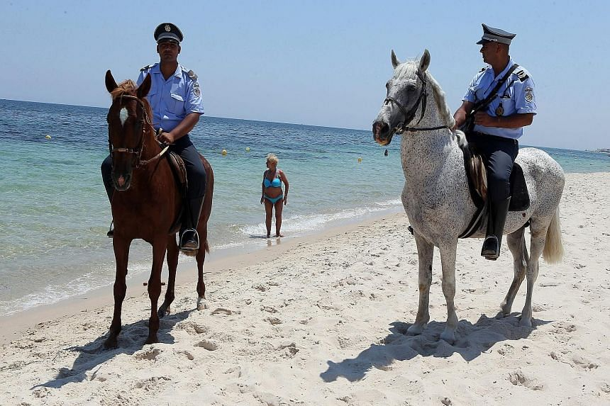 Tunisia has deployed about 3,000 armed policemen in hotels and on beaches to protect tourists, following an Islamic militant's deadly rampage at the popular tourist resort of Sousse.