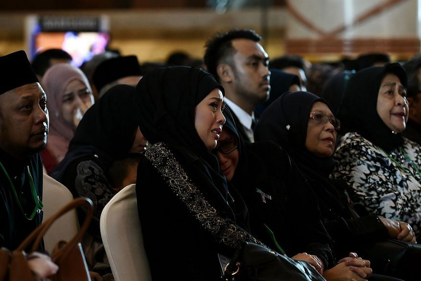 Family members of MH17 victims attending a memorial service to mark the first anniversary of the tragedy.