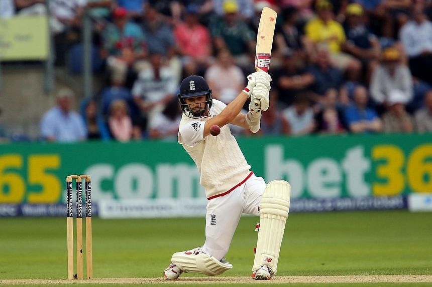 England batsman Mark Wood playing a shot on the third day of the opening Ashes cricket test match against Australia.