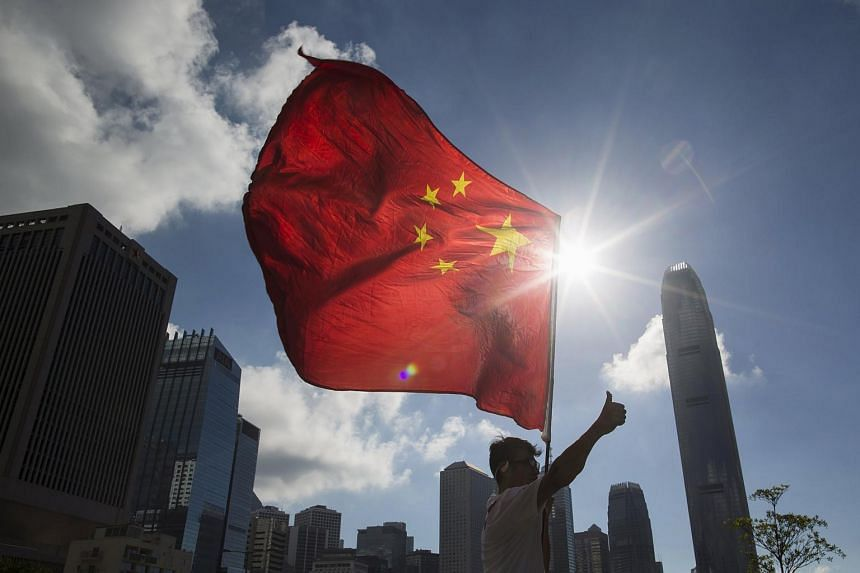 A pro-China supporter walking with a Chinese flag during a demonstration in Hong Kong.