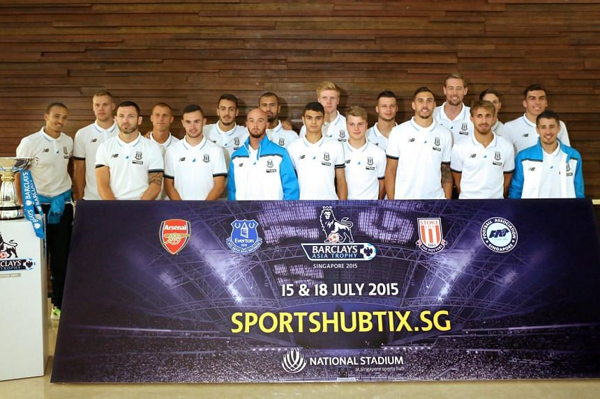 The Stoke City team with the Barclays Asia Trophy.