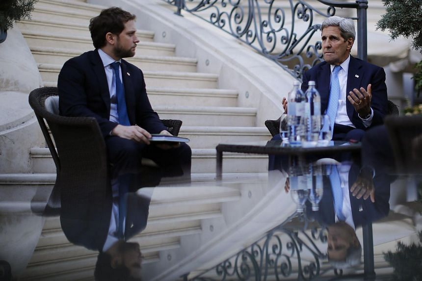 US Secretary of State John Kerry and State Department Chief of Staff Jon Finer (L) at the garden of the Palais Coburg hotel where the Iran nuclear talks meetings are being held in Vienna, Austria.
