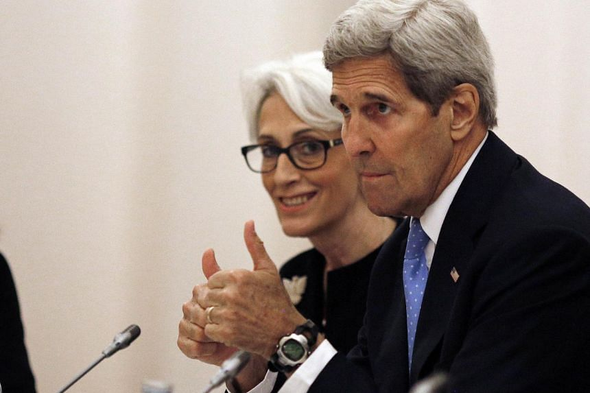 John Kerry (right) and US Under Secretary for Political Affairs Wendy Sherman.