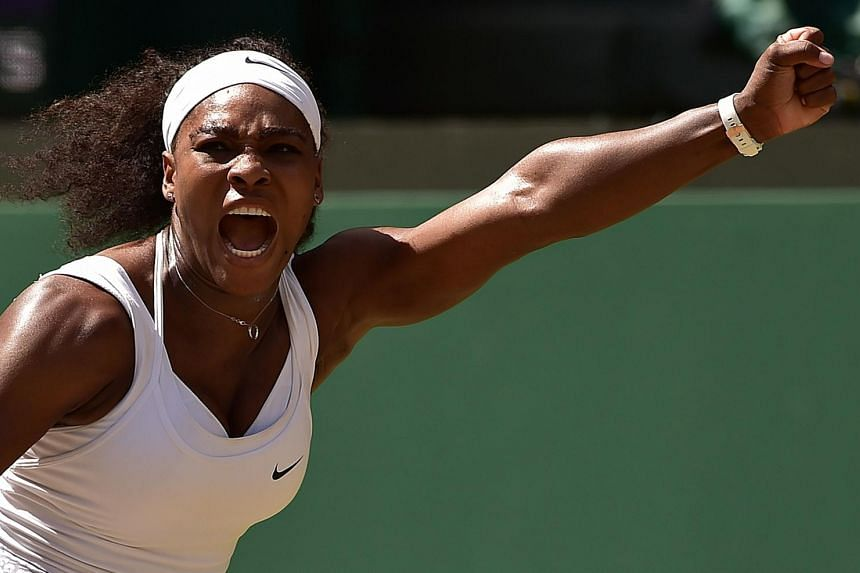 Serena Williams celebrates after a point against Garbine Muguruza during the women's singles final on day twelve of the 2015 Wimbledon Championships.
