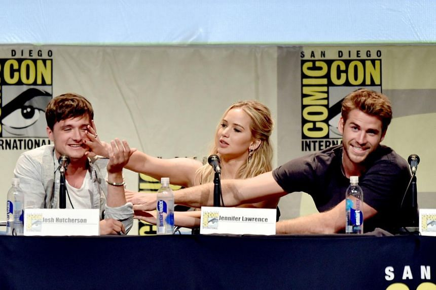 (From left) Hunger Games actors Josh Hutcherson, Jennifer Lawrence and Liam Hemsworth at Comic-Con, where fans were given an exclusive peek of the Mockingjay - Part 2 trailer.