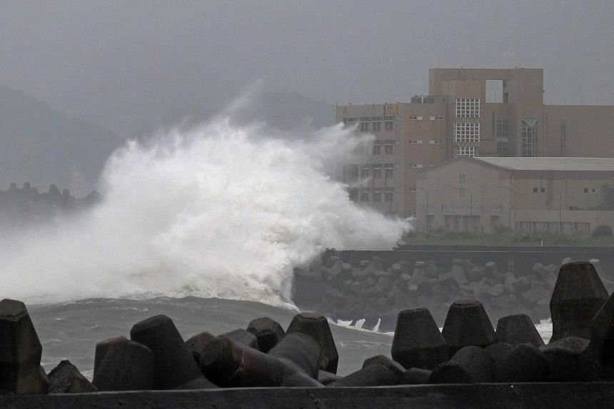Giant waves crashing into the coastline at Keelung in northern Taiwan as Typhoon Chan-hom passed the island yesterday.