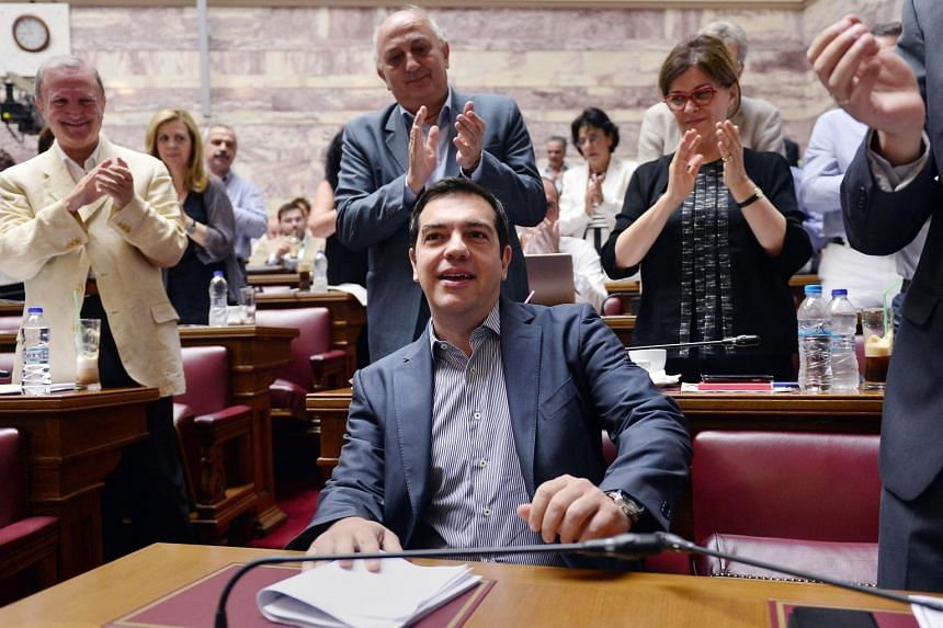 Greek PM Alexis Tsipras attends his party's parliamentary group meeting at the Greek parliament.