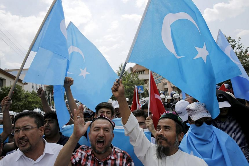 Demonstrators shout slogans as they attend a protest in front of the Thai Embassy in Ankara, Turkey, Thailand confirmed on Thursday it had forcibly returned nearly 100 Uighur migrants to China.