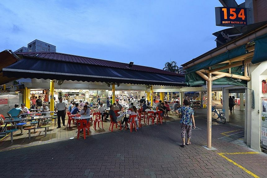 Mr Paul Kok Kuan Pow reportedly runs more than 20 coffee shops in Singapore. Mr Tan Han Swee and his wife, Madam Yiap Moi Hiang, at a Hungry Ghost Festival event in 2004. Yong Xing Coffee Shop at Bukit Batok Street 11 (left) is a popular dining spot