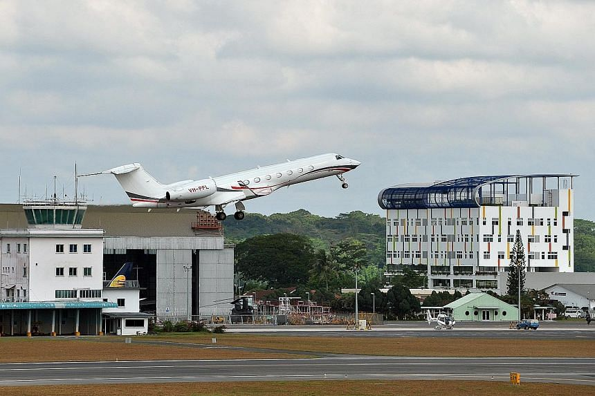 A Gulfstream G550 VH-PFL aircraft taking off from Seletar Airport on Feb 10 2012. Seletar Airbase (left) was used as a military airport (above) when it opened in 1930.
