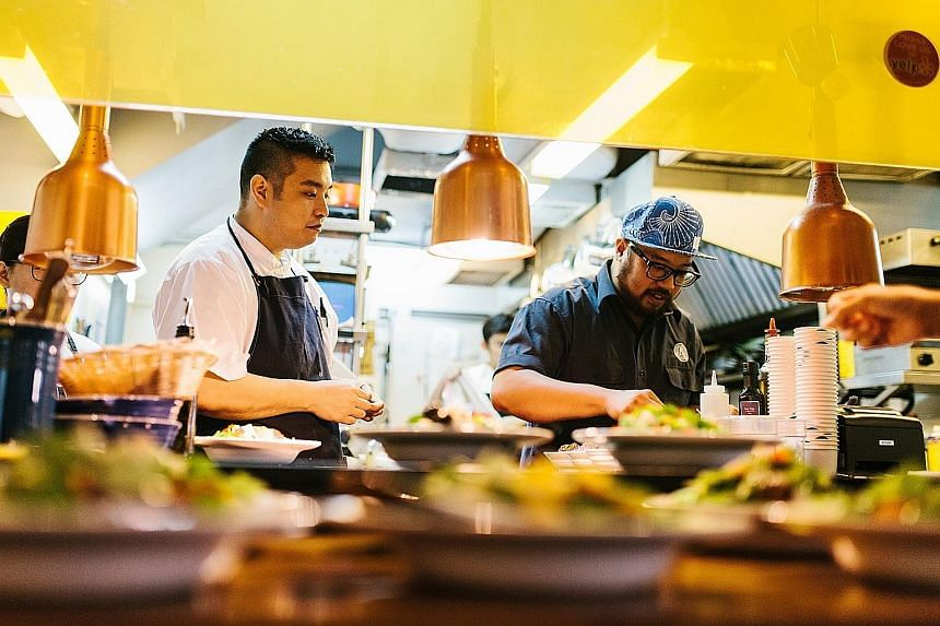 Cocotte's head chef Anthony Yeoh (above left) and Artichoke's chef-owner Bjorn Shen held an event last month serving fried chicken (left). From far left: Moosehead's head chef Drew Wilson, sisters and co-owners of Warong Nasi Pariaman Martina Emrin a