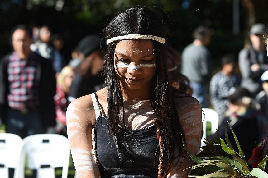 A woman performing in a smoking ceremony last Monday in Sydney to open Naidoc Week, organised by the National Aborigines and Islanders Day Observance Committee.