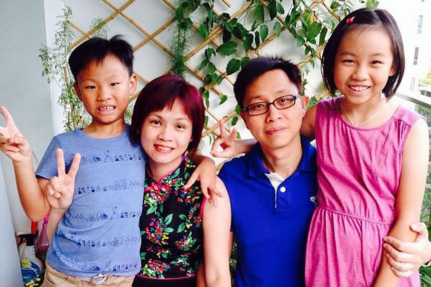 Mr Benedict Lo (far left) with his grandmother Tan Giok Kit, (standing, from left) younger sister Grace, wife Lim Pei Li and mother Tan Lee Yong at this year's Chinese New Year gathering. Mr Sebastian Tan and his daughter, Kaizaree Jade-Eden, whom he
