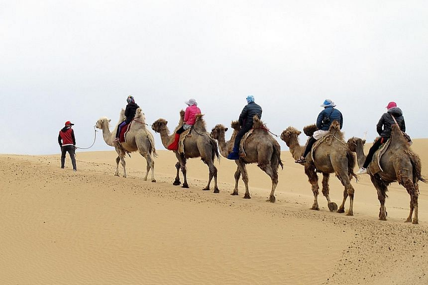 Ride a camel in the Xiangshawan Desert. A familiar sight in Inner Mongolia is the aobao, a mound of rocks and wood often found on the top of mountains. The Muslim district in Hohhot has many shops selling bread, halal dumplings and a variety of stree