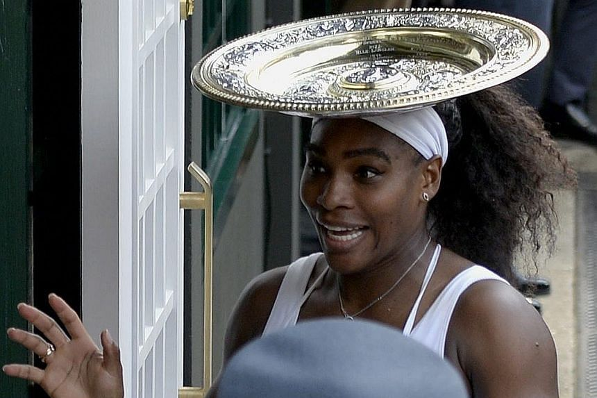 Williams holds the Venus Rosewater Dish, awarded to the Wimbledon women's winner, for the 6th time in her career.