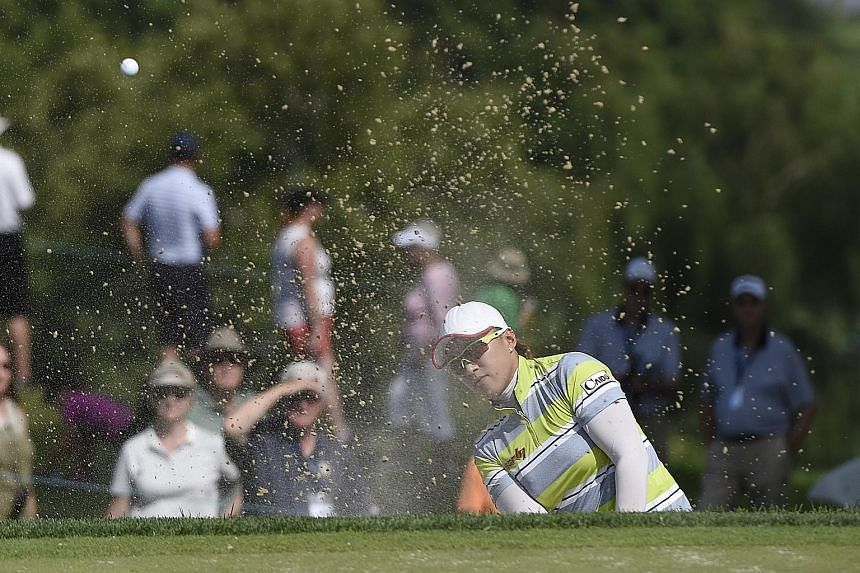 Amy Yang, shooting from a bunker on the ninth hole during the second round of the US Women's Open, could be on her way to claiming her first Major triumph after posting a three-shot lead at the halfway stage.