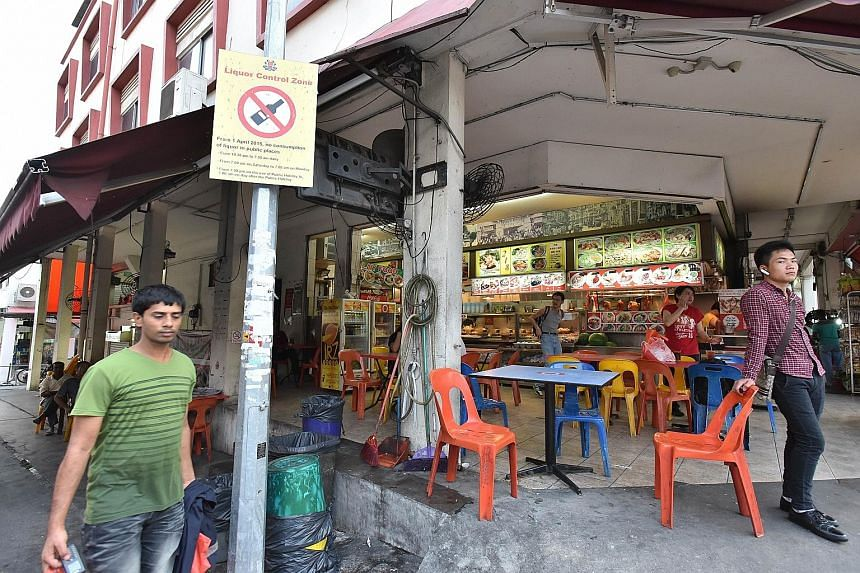 The new limits on alcohol sales are more stringent in Geylang (above) and Little India. Some neighbourhood stores that used to stay open till midnight are now closing earlier as they cannot sell liquor.