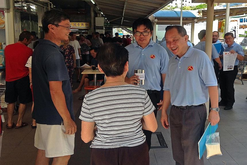 Aljunied GRC MP and Workers' Party secretary-general Low Thia Khiang (right) meets Kaki Bukit residents during a Sunday walkabout.