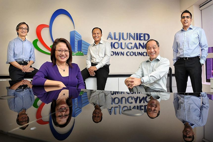 Aljunied GRC MPs from the Workers' Party (from left) Chen Show Mao, Sylvia Lim, Muhamad Faisal Abdul Manap, Low Thia Khiang and Pritam Singh at their town council office in Hougang.