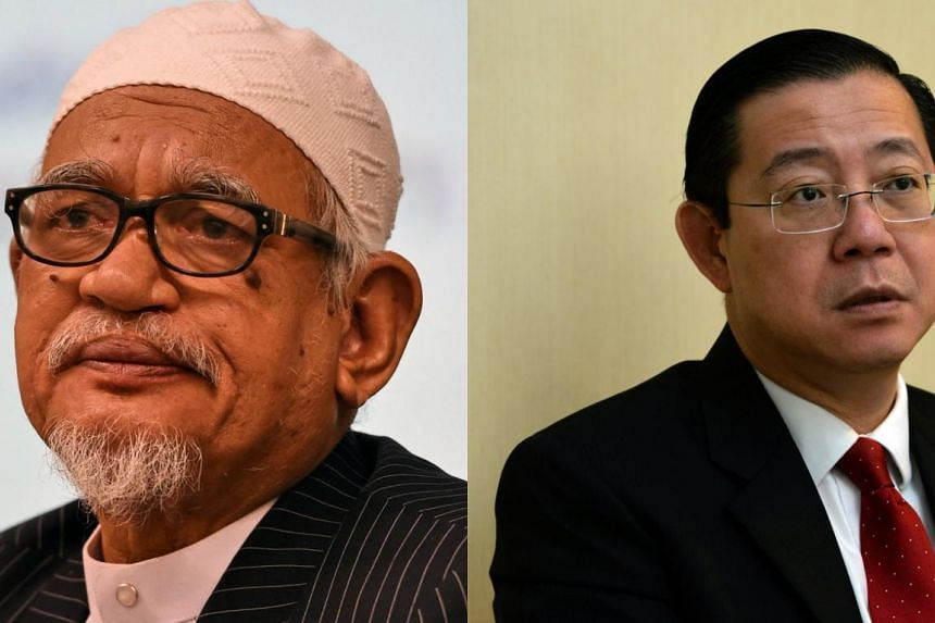 Parti Islam SeMalaysia (PAS) president Hadi Awang (left) and Democratic Action Party (DAP) secretary-general Lim Guan Eng. The highest decision-making body in PAS, the Syura Council, yesterday said it has decided to uphold a decision by party members