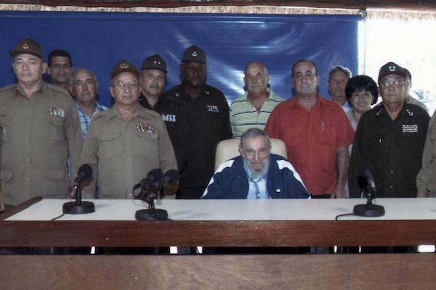 Fidel Castro (sitting) with officers and civil servants in a July 9 photo in Havana.