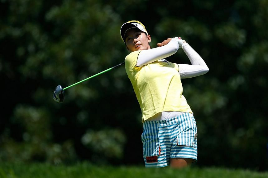 Choi watches her tee shot on the 14th hole during the third round of the US Women's Open.