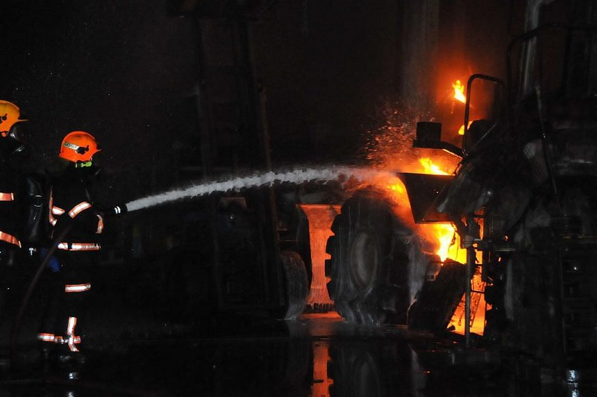 Firefighters at work during the fire in Jurong on Saturday night.