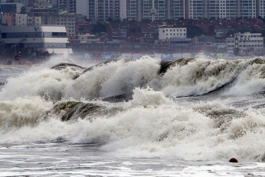 High waves generated by Typhoon Chan-hom hitting the coast in the south-eastern port city of Busan on July 12, 2015. Domestic flights were cancelled in South Korea on July 12, as Typhoon Chan-hom brought strong winds and heavy rainfall to southwester