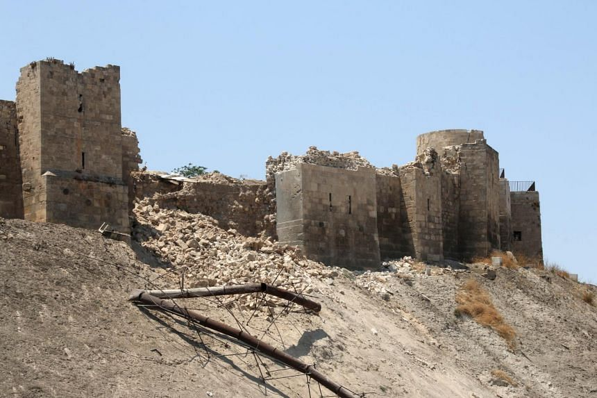 A damaged wall of Aleppo Citadel following a reported explosion the previous night in a tunnel near the monumental 13th fortress on July 12, 2015.
