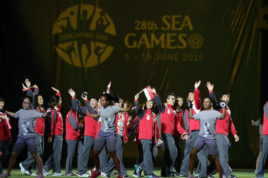 Athletes walking into the National Stadium during the closing ceremony of the 2015 SEA Games, on June 16, 2015.
