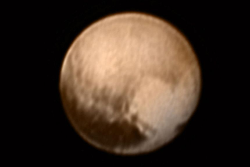 Pluto is pictured in this July 7, 2015 handout image from New Horizons' Long Range Reconnaissance Imager (Lorri).