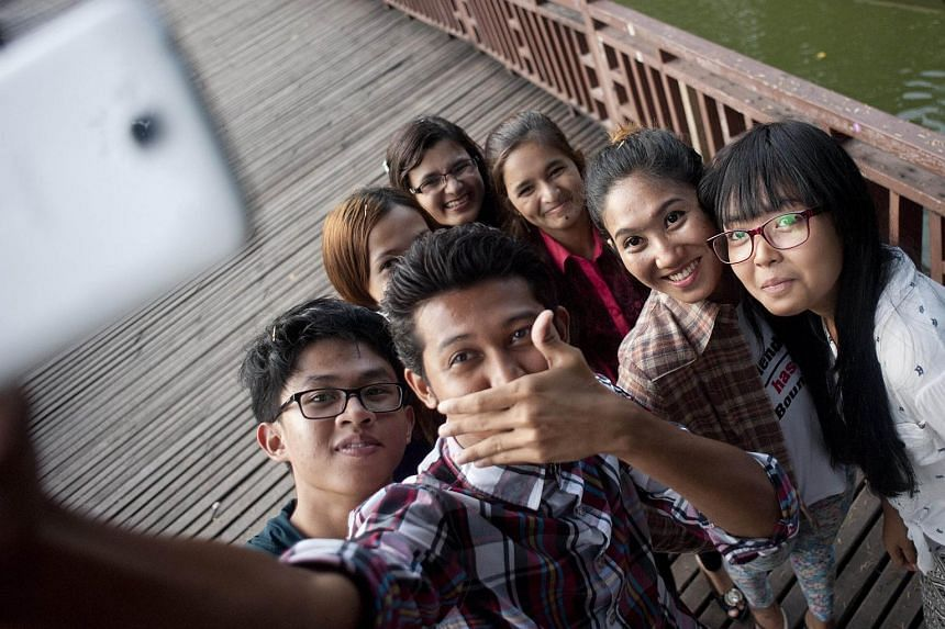 Campaigners from different religions and ethnic groups pose for a selfie at the KanDawGyi Lake in Yangon.