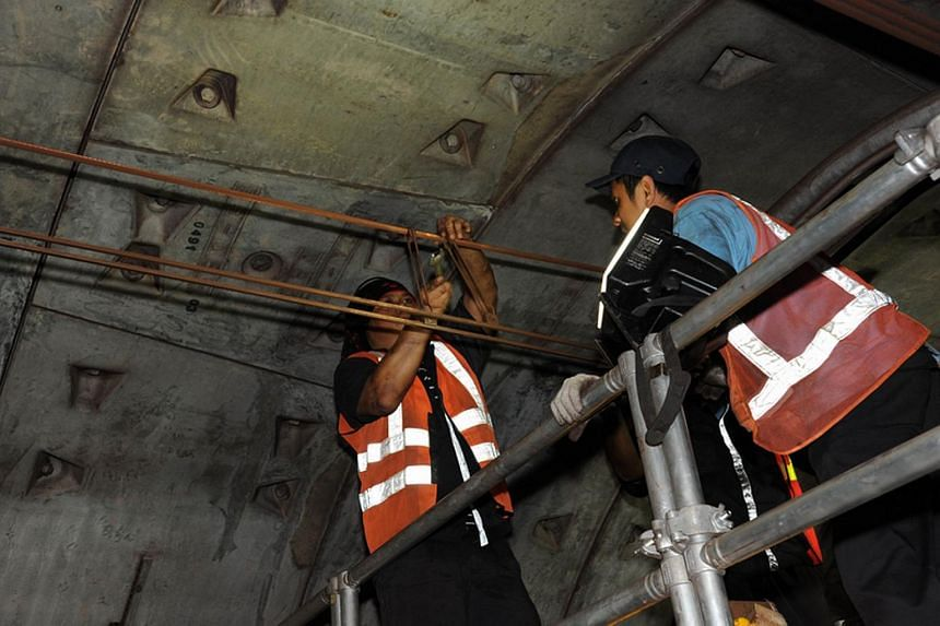 Engineers working in the train tunnel.