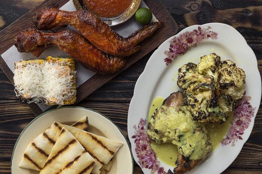 Clockwise from left bottom: Moosehead's charcoal-baked flat breads, Ah Hwee BBQ Chicken Wings with Moosehead's charcoal-grilled sweet corn, Sriracha mayonnaise and grated parmesan, and Warong Nasi Pariaman's ayam bakar and charcoal-grilled caulif
