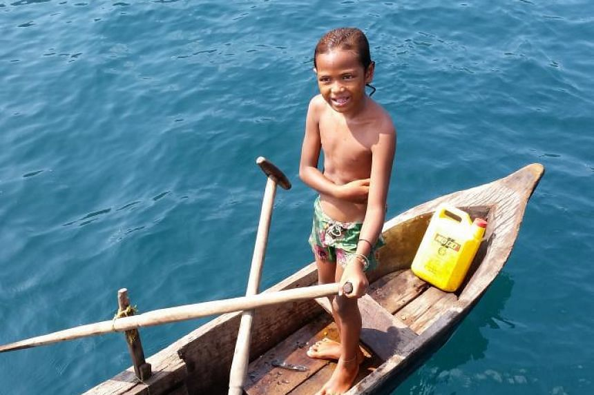 Moken children learn to fish and dive to great depths without any equipment from an early age.
