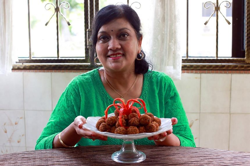 Senior tax officer Rita Balasurian with her family's favourite snack, mutton cutlets.