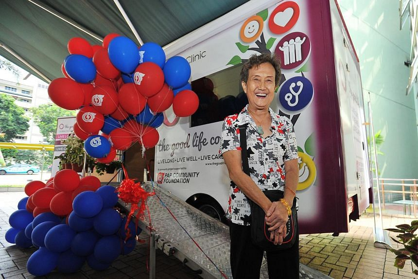 Retiree Teo Kin Nang standing in front of the Wellness Bus at The Serangoon Community Club on July 12, 2015.
